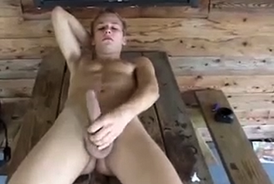 Teen boy naked and wanking outdoors on a picnic table