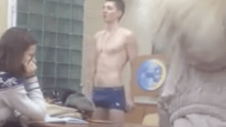 Russian boy strips naked at school in class